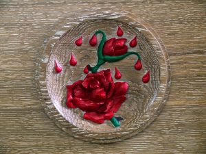 Hand Carved Oak Roundel of Rose and drops of blood