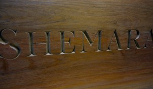 Teak Board with incised hand carved lettering